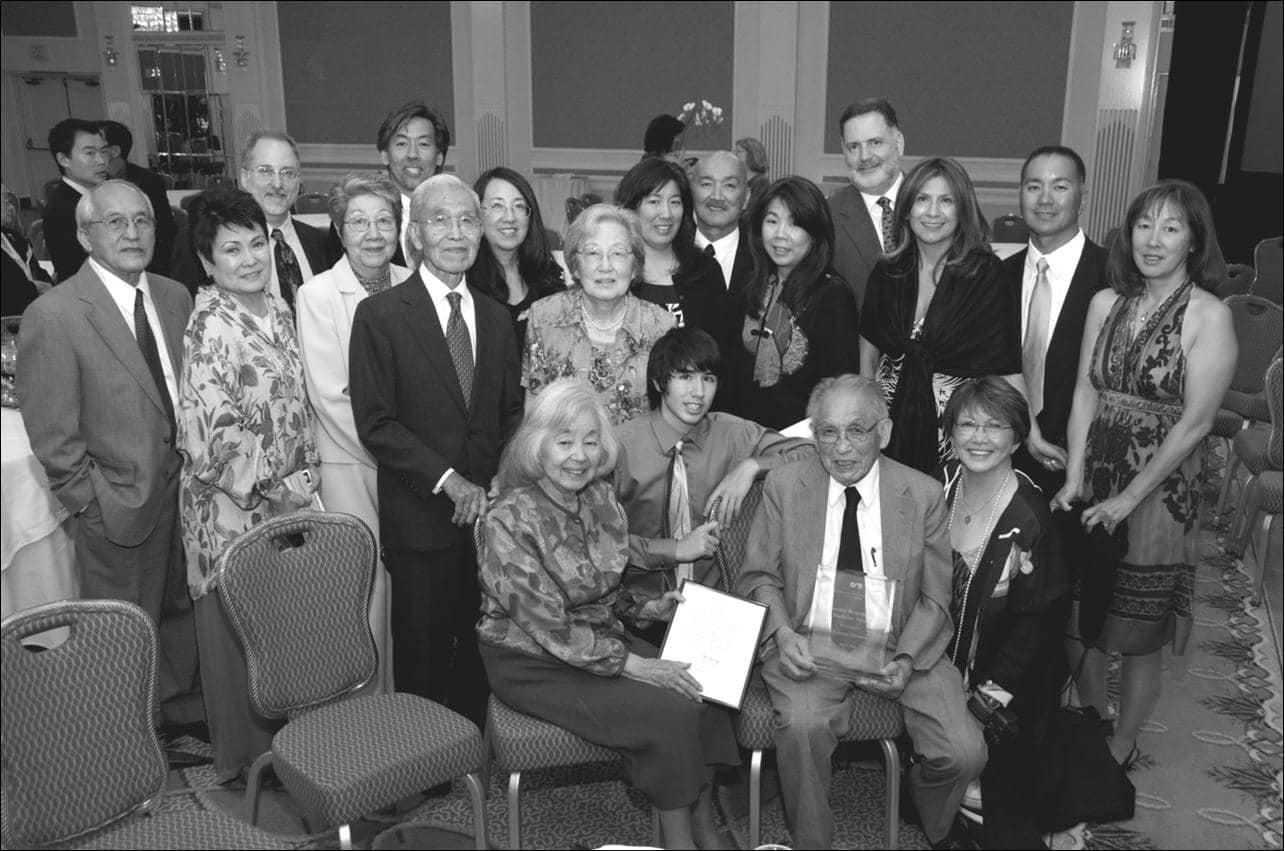 Dr. James Yamazaki, recipient of the Socially Responsible Medicine Award, with many of his family members at the dinner.